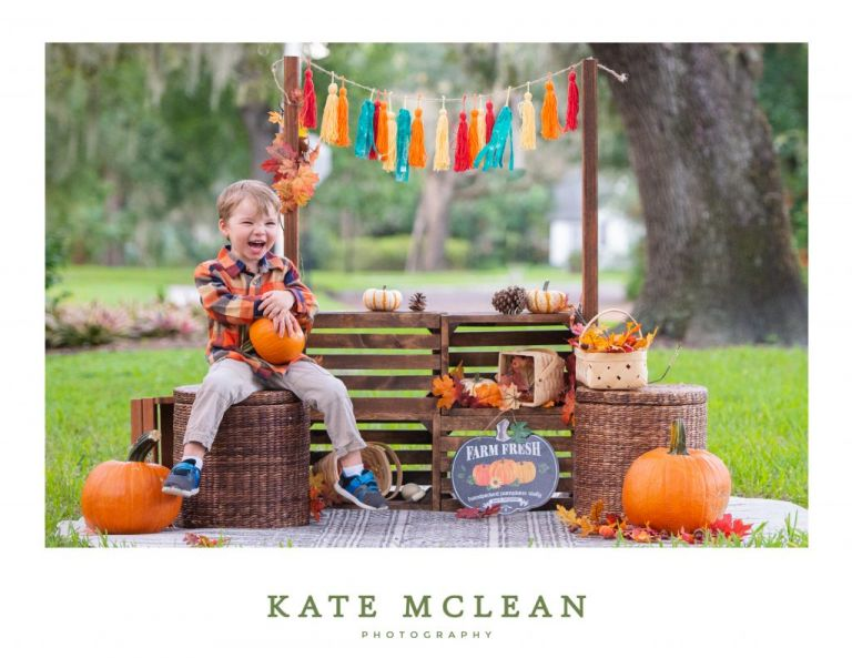Pumpkin Patch Mini Sessions in Florida Boy Laughing Candid Image